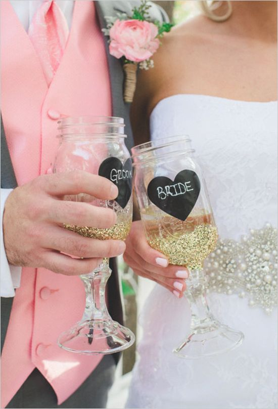 Mason jar wine glasses with chalkboard heart and gold glitter. Captured By: Park Road Photography ---> http://www.weddingchicks.com/2014/05/08/shabby-chic-western-wedding/
