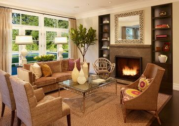 Living room vases lamps pillows books mirror plate fig tree
