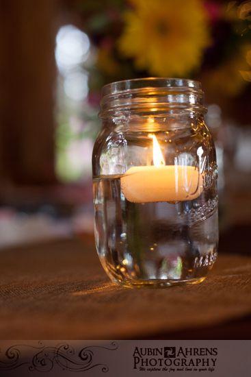 floating candles in mason jars liz spencers wedding