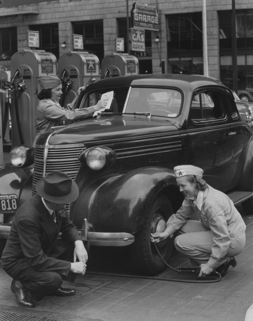 Female gas station attendants assist a customer in San Francisco, CA - 1942  DURING WWII