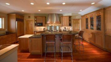 Beautiful custom hood, commercial range, and kitchen island, maple