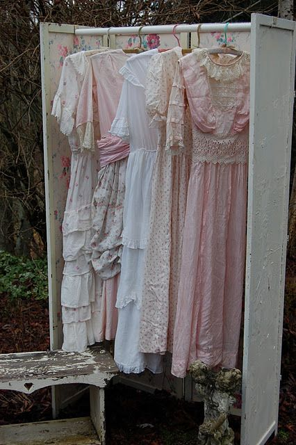 dresses...folding rack with pole...great for doing shows  Use my tall shutters..r canvas,.screen trellis