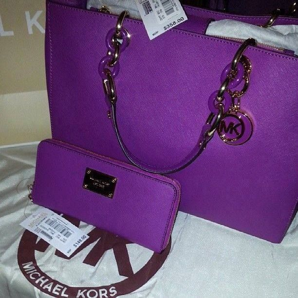 purple Michael Kors bag and wallet