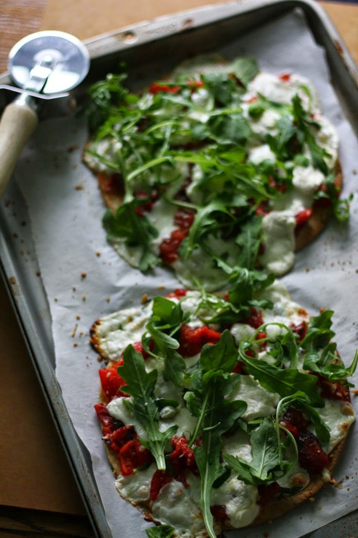 Pizza With Eggs, Roasted Red Peppers, Olives, And Arugula Recipe ...