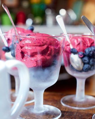 ONE MINUTE ICE CREAM: Frozen berries, Greek yogurt and honey all in a blender.