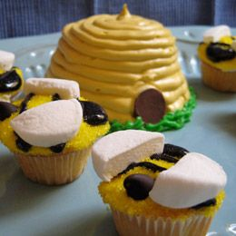 Beehive cake and honey bee cupcakes.