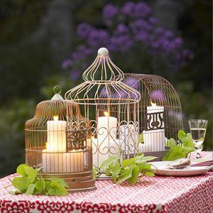 A trio of decorative birdcages serves as a charming spring centerpiece.