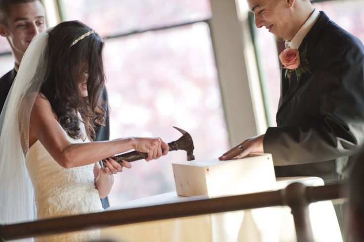 BEST IDEA EVER!  Write love letters to each other on the eve of wedding day, place them in a box with wine and nail it shut. When you have your first fight, open it up, pour the wine, go to separate corners, read the love letter & remember what it's all about.