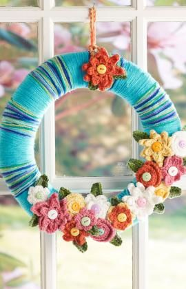 April flowers, found on : http://www.redheart.com/free-patterns/april-flowers-wreath