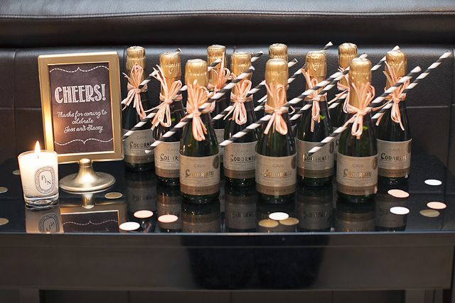 Mini champagne bottle favors with striped straws - Ashley Lindzon Events