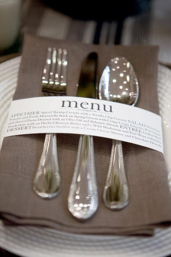wedding menus; purple napkin, silver utensils, white menu with purple writing WHITE PLATES