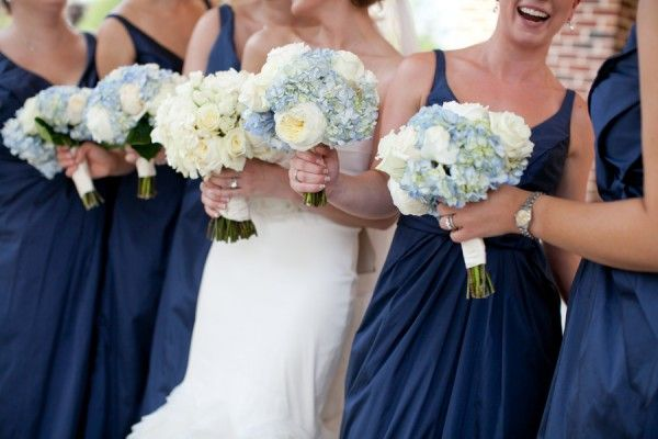 Navy-Bridesmaids-Dresses with blue hydrangeas in the bouquets.