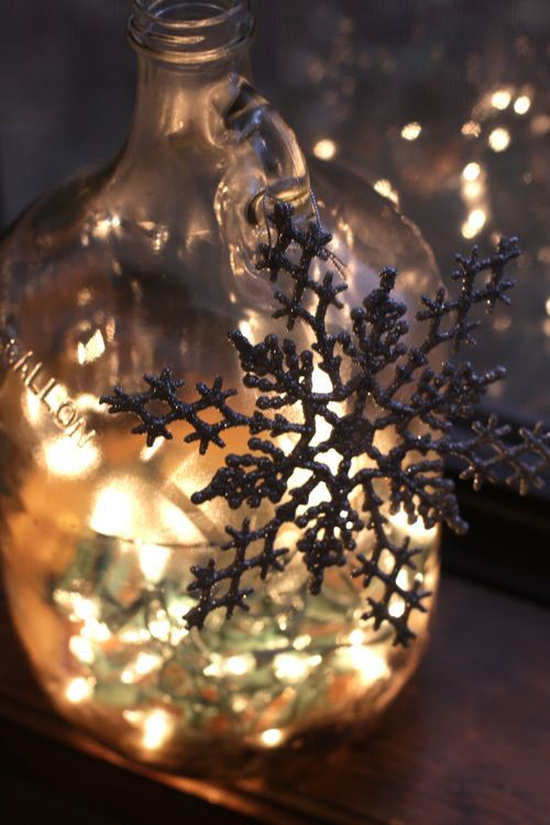 DIY: Fill a bottle with twinkle lights! Drill through the glass at the bottom, so the plug can trail out. (Click for full tutorial.)