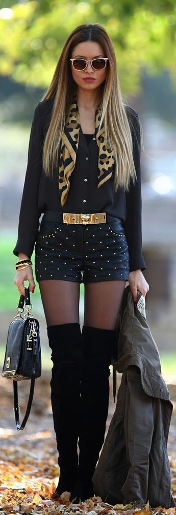 blue mini short, black shirt and long black boots