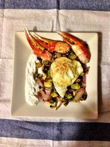 brussels sprouts with fried egg and curry spiced yogurt salad