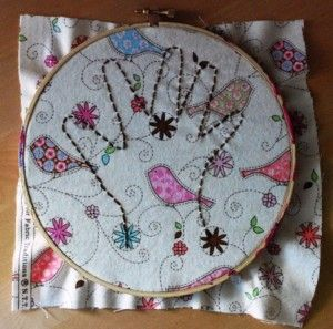 embroider your child's hand print.  cute simple gift idea!