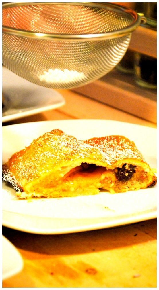 Apples and raisins wrapped in fresh puff pastry dough. Cooked until ...
