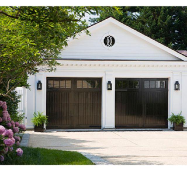 shiny black garage doors inviting exteriors pinterest
