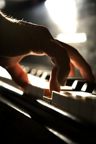 His fingers ran like spiders up and down the keys, playing a soft melody that tugged on the heartstrings of anyone near enough to hear the soulful sounds.