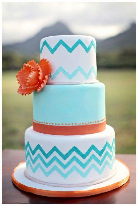Aqua and orange chevron patterned wedding cake.
