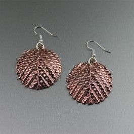Exquisitely artful, these #Fold-formed Corrugated #Copper Disc earrings are polished to a mirror-like shine.