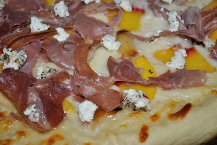 ... pizza with white sauce, prosciutto, peaches, roasted garlic, and goat