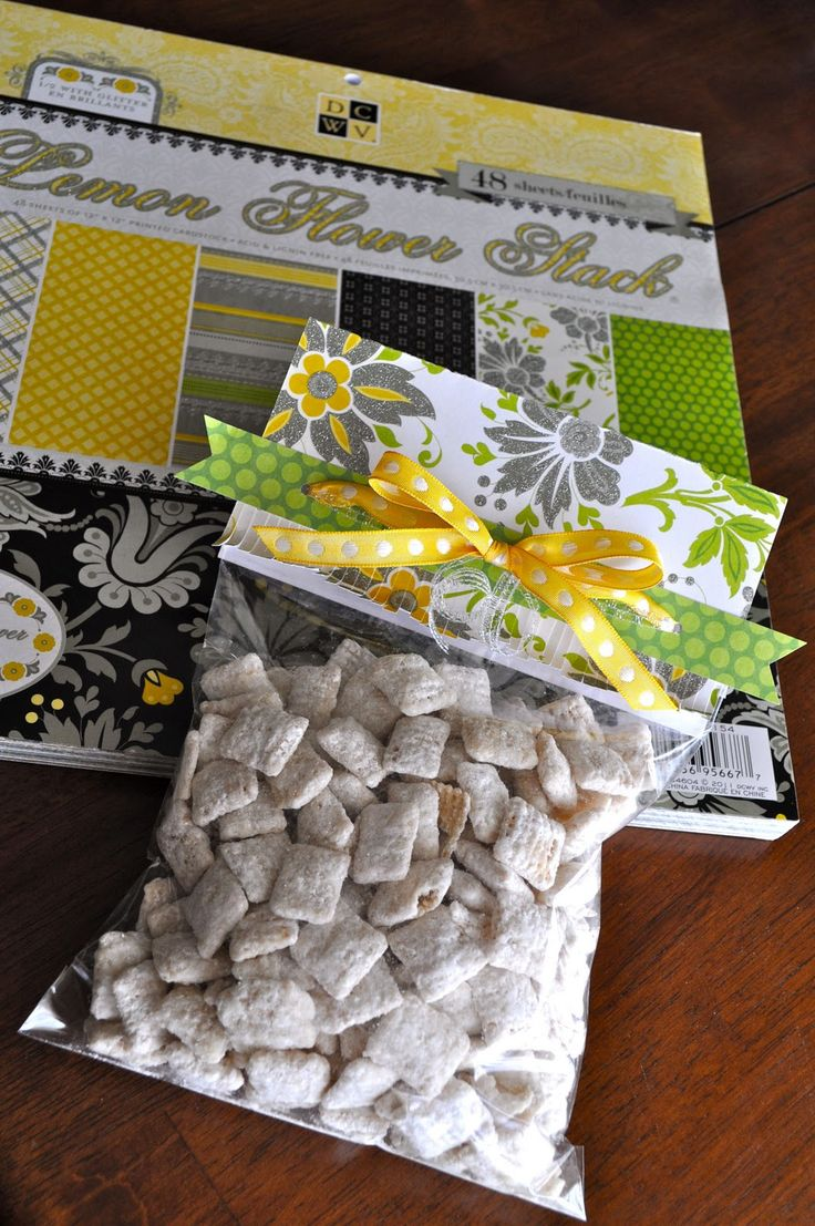 Cute idea - ziploc bags, scrapbook paper, and ribbon!