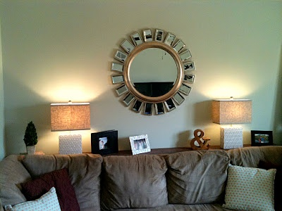 """shelf behind the couch: wood stained and attached to the wall with """"L"""" brackets"""