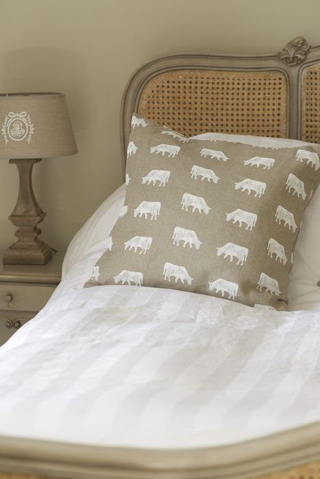Cushion in Emily Bond Dairy Cow fabric http://www.emilybond.co.uk/store/square-cushions/