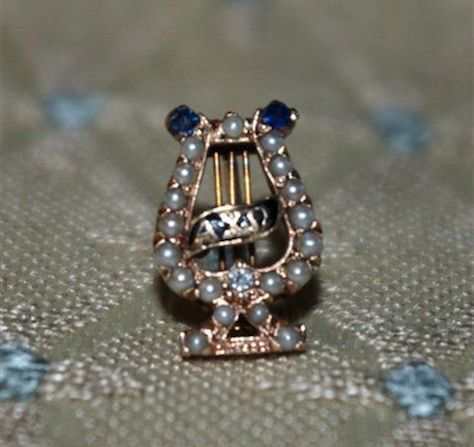 Found on greekc... Phi Mu Badge Pearl