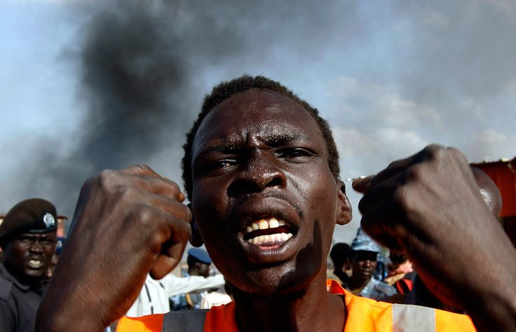 A man reacts at a market burnt in an air strike by the Sudanese air force in Rubkona near Bentiu on April 23. (Goran Tomasevic/Reuters) #