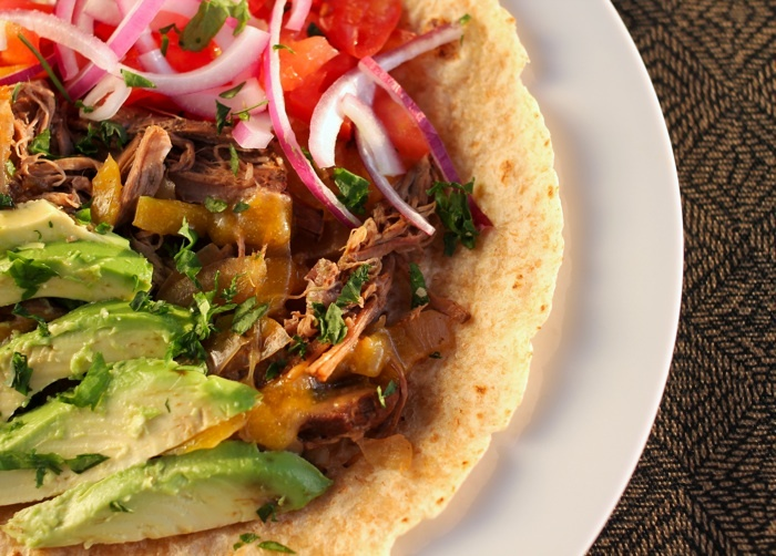 Barbacoa beef with avocado, onions, tomatoes in tortilla... made in ...