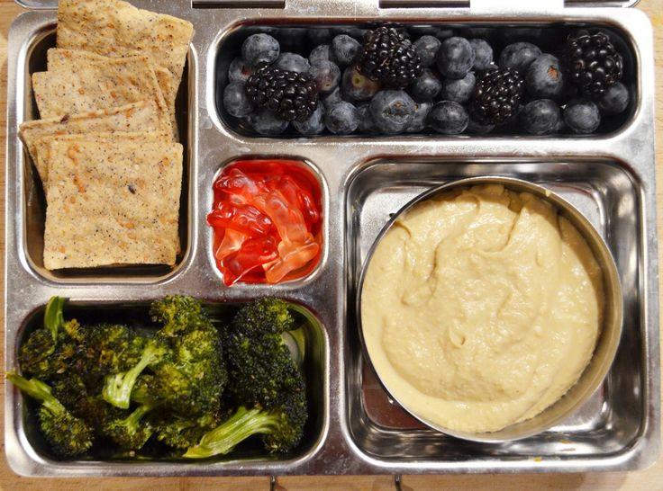 Hummus, roasted broccoli, black bean chips, blueberries, blackberries ...