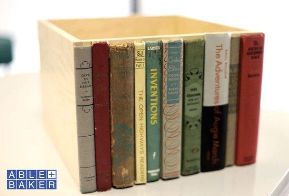 Broken book spines glued to a box. Storage for a shelf