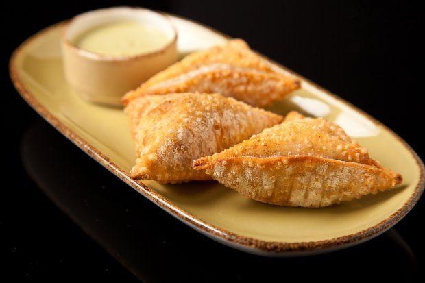 Golden-brown chicken ropa empanadas: little hot pockets of happiness.