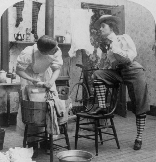 Is it just me, or does the person doing the laundry look like a man? If so, I sense that the message of this photo was that of the (perceived potential) shift in gender roles if (goodness forbid! ;D) women started wearing pants. #Victorian #humor #fashion #1800s #homemaker