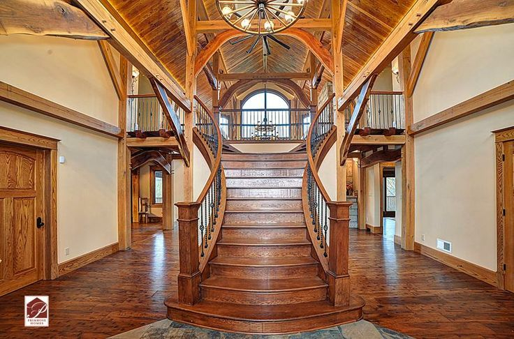 grand double staircase in timber home Grand Double Staircase