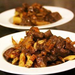 Stoofvlees, Hearty Beef Stew over Fries, Belgian inspired dish