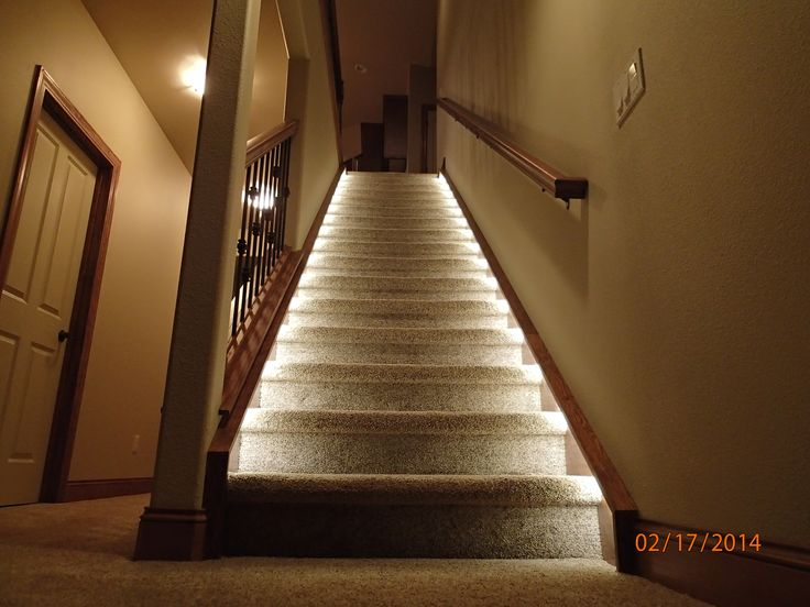... LED strip lights stick under the boards and light the stairs at night