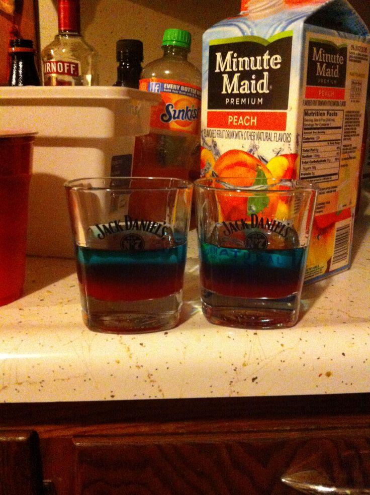 Bomb pops!!! Uv blue, raspberry vodka, strawberry margarita mix.