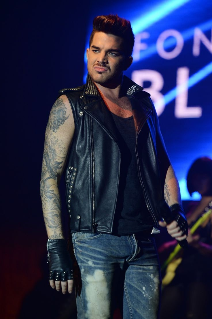 """""""Hey, I know I look good."""" Adam Lambert struts onstage during a performance on Nov. 30 in Miami Beach, Fla."""