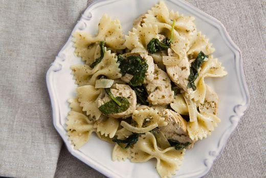 chicken Florentine with pasta and basil pesto. Sliced sauteed chicken ...
