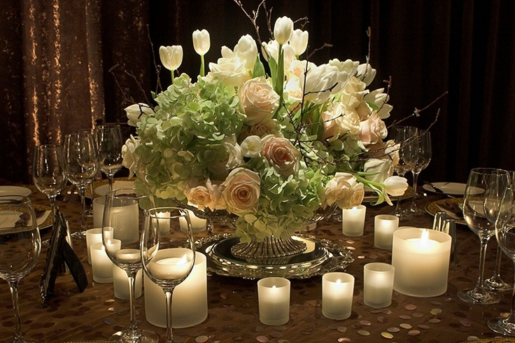 Love the frosted candle holders around the white ivory centerpiece