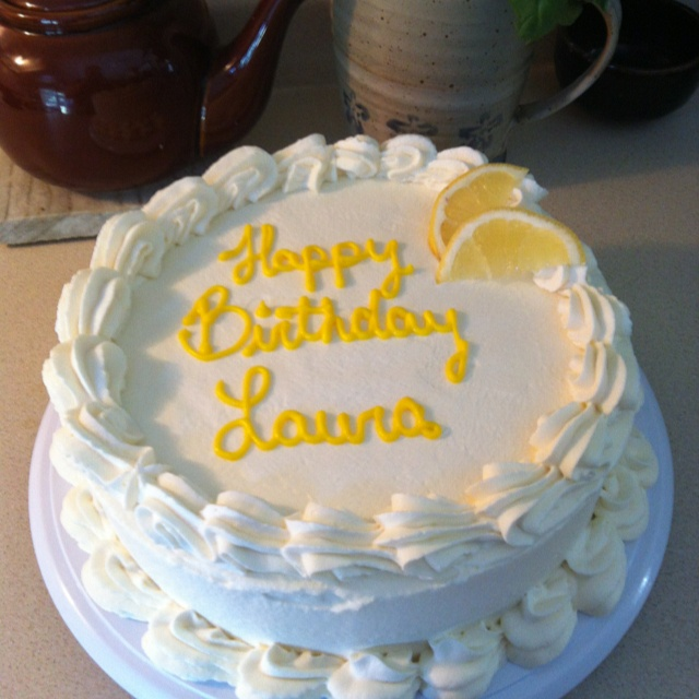 White cake with lemon curd filling and whipped cream frosting.