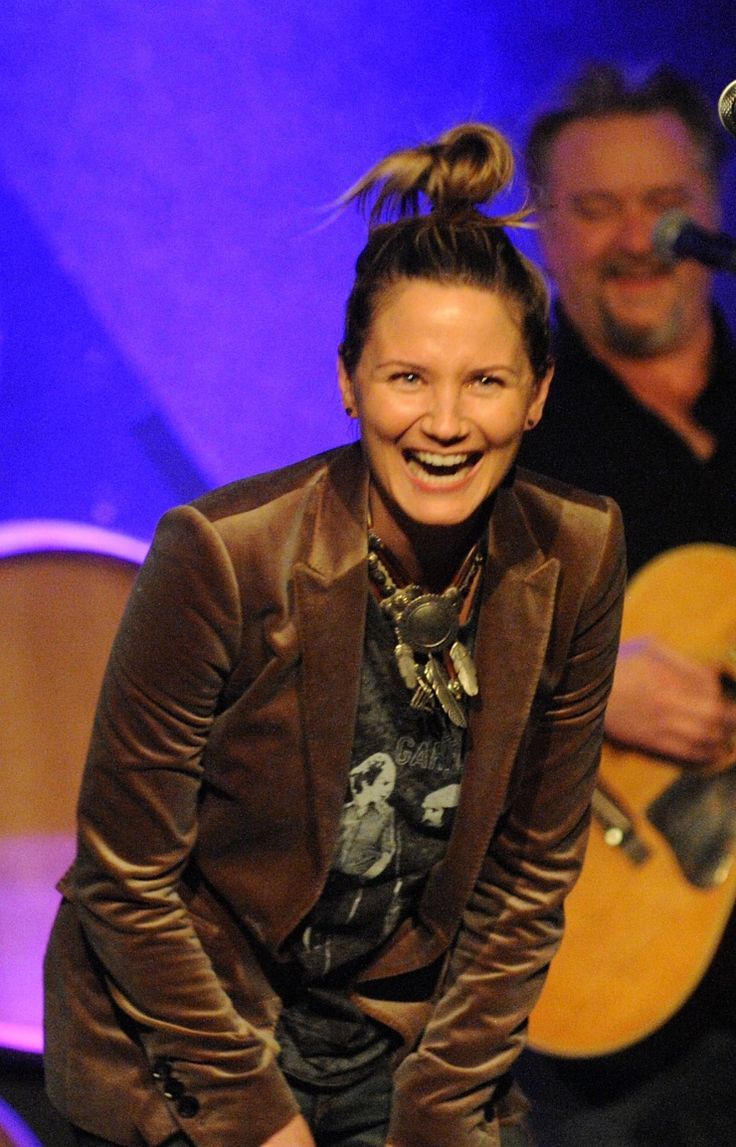 """Hey, what's so funny?"" Sugarland's Jennifer Nettles doubles over in a fit of laughter during a performance on Jan. 7 in New York"