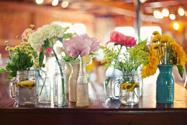 love the different vases/jars/containters with different flowers...to decorate party or wedding