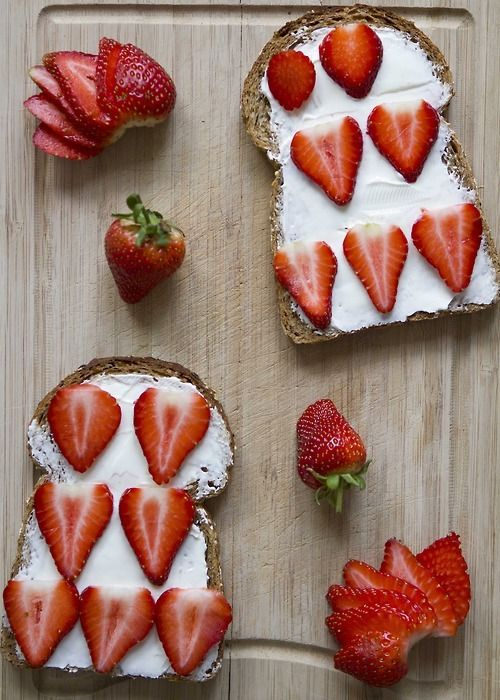 strawberry and sour cream cheese on the bread. delicious breakfast ...