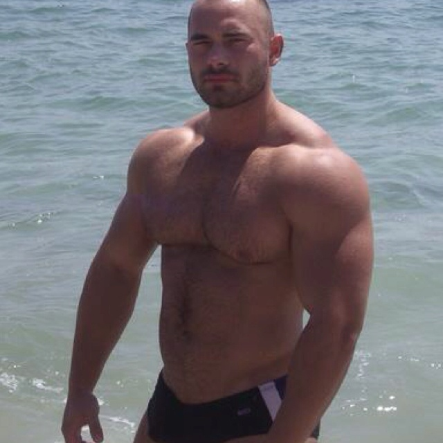 Hot muscle beefcake in black speedos on the beach... Too dang sexy. What do u think?