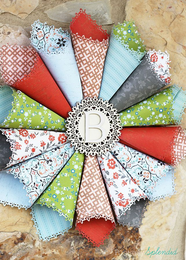 This rolled paper wreath is such a great way to use pretty patterned papers!