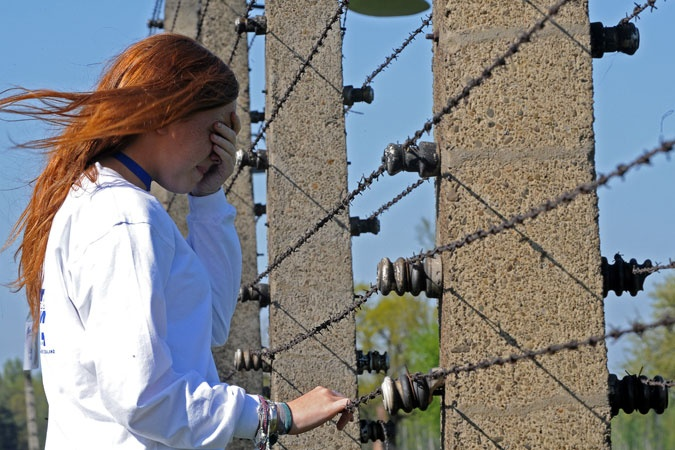 A sad memory-A Jewish girl visits the Auschwitz-Birkenau death camp during the annual March of the Living in Oswiecim, Poland. The march commemorates the 6 million Jews who perished in concentration camps during World War II.